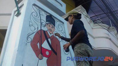 Sejumlah seniman melukis gapura di Kelurahan Kledung Kradenan, Banyuurip Purworejo