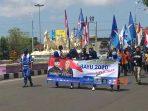 Pasangan Agus Bastian-Yuli Hastuti dan pendukung berangkat ke kantor KPU untuk mendaftar menjadi peserta Pilkada Purworejo 2020