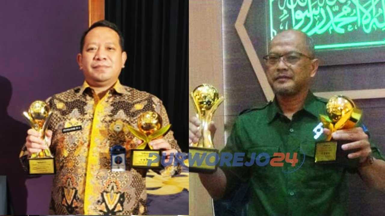 Direktur PDAM Perwitasari Purworejo, Hermawan Wahyu Utomo dan Dirut Bank Purworejo Wahyu Argono Irawanto menunjukkan tropi penghargaan Top BUMD Award 2021 Bintang 4 dan Top CEO BUMD 2021